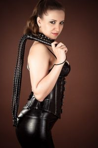 Femdom Mistress with leather whip